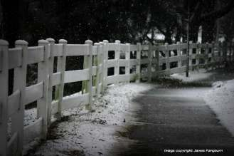 fence with snowy walkway