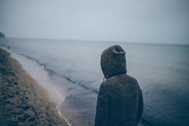 young woman along shoreline