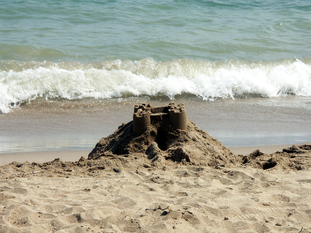sandcastle with wave