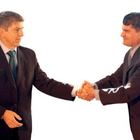 hand shaking businessmen