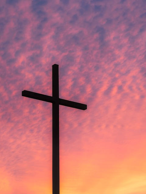 cross with colored sky