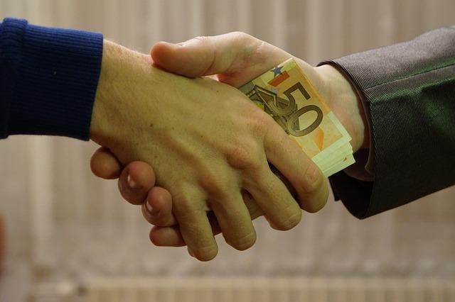 money passed in handshake