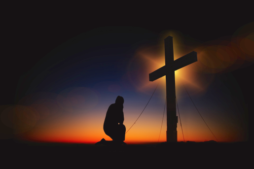 kneeling at cross