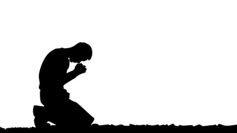 kneeling in prayer