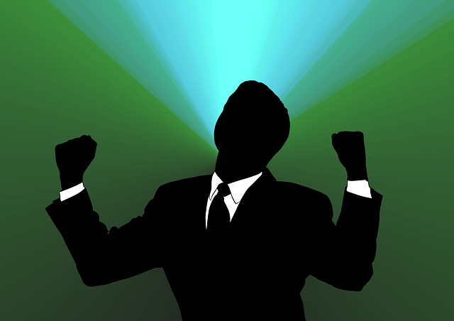 a silhouette of a man with fists raised in victory