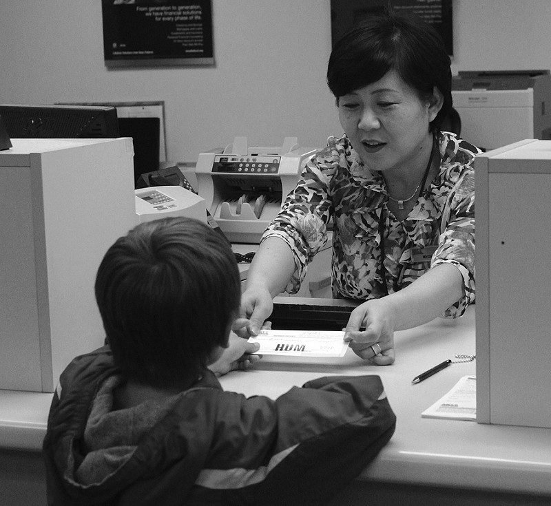 bank teller with child