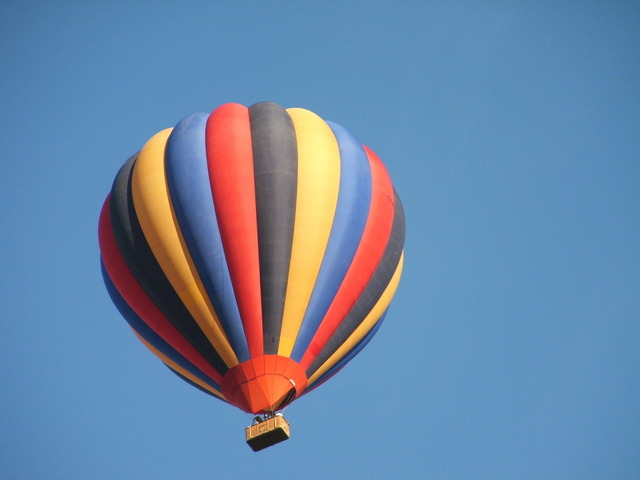multi-colored balloon floating in sky
