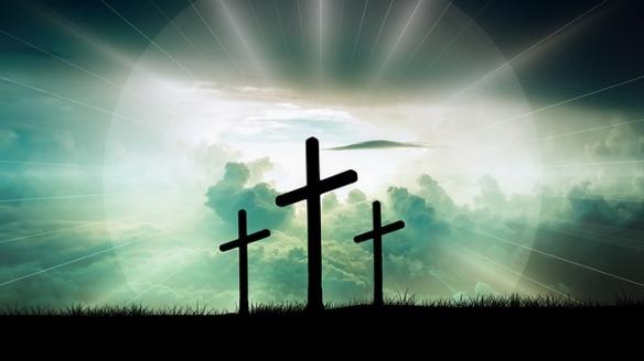 three crosses in a field