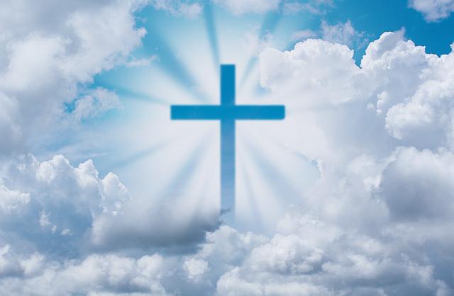 cross in clouds