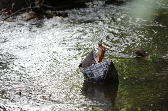 paper boat floating on stream