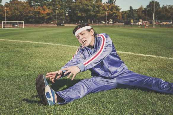 woman exercising in athletic field