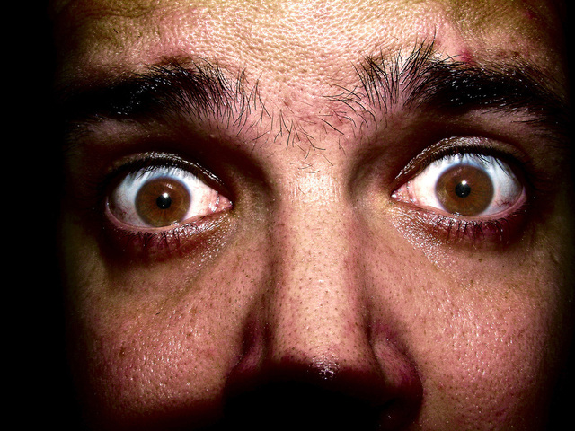 headshot closeup of fearful man
