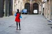 black mannequin red dress