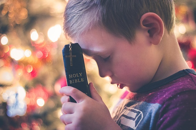 boy holding bible