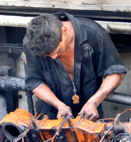 engine mechanic working