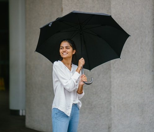 woman smiling with umbrella