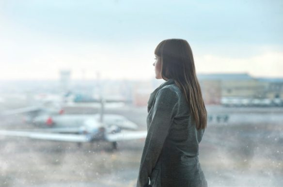 woman looking at planes