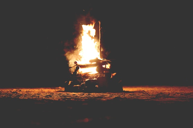 A bonfire at night with large flames
