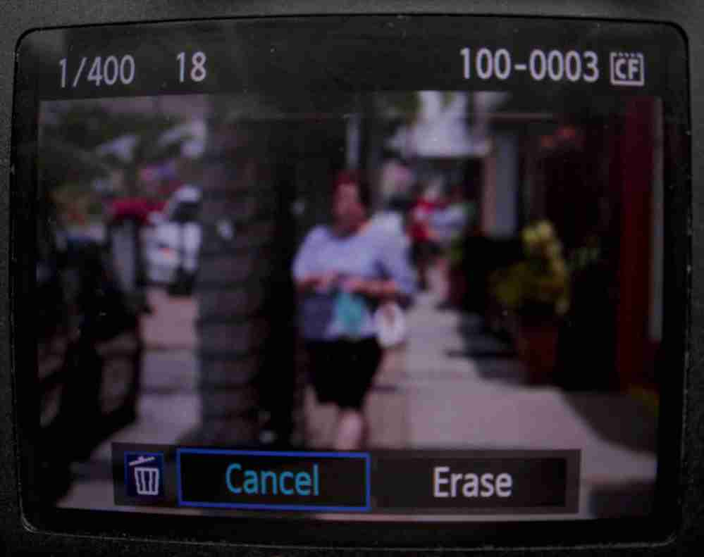 A preview from a digital camera of a blurred street scene