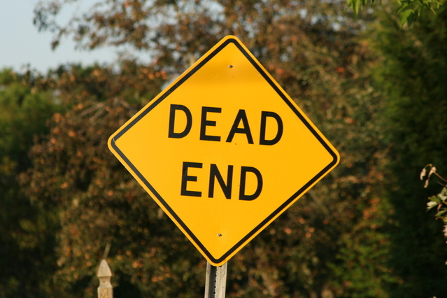 A yellow street sign displaying the words 'dead end.'