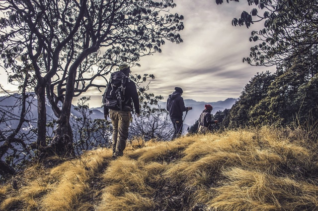 hikers on small clearing of hill