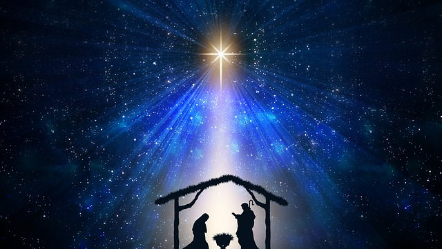 graphic image of manger silhouette with star overhead directing a beam over the scene