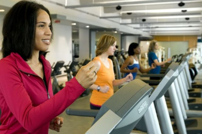 several women using treadmills in a gym