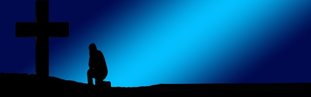 graphic of blue background with a silhouette of person kneeling at a cross