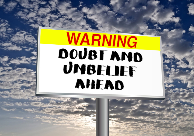 Clouds, blues sky and a billboard with words: Warning: Doubt and Unbelief Ahead