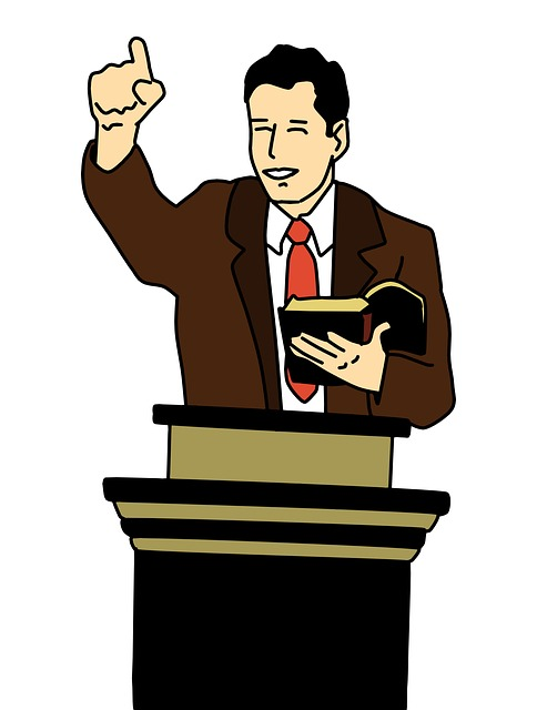 drawing of a man preaching behind pulpit while holding a Bible