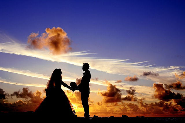 Silhouette of bride and groom with sunset behind
