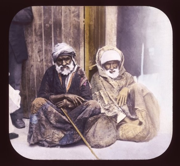 A color slide of a pair of seated beggars in Alexandria, Egypt.