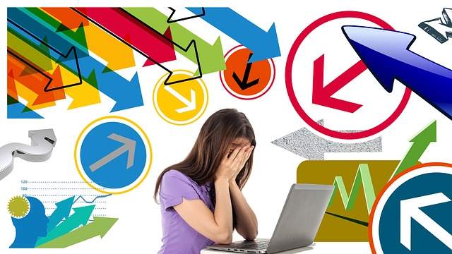 A photo and graphic of a woman in front of a laptop with hands over her face and arrows of all kinds pointing at her.