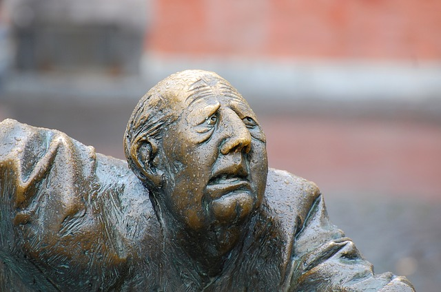 photo of sculpture at Aachen Elise Fountain of man's face in suffering
