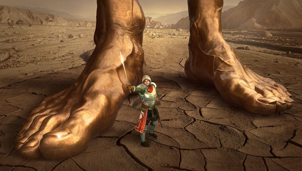 Fantasy illustration of a small warrior standing between two giant feet in a desert wilderness