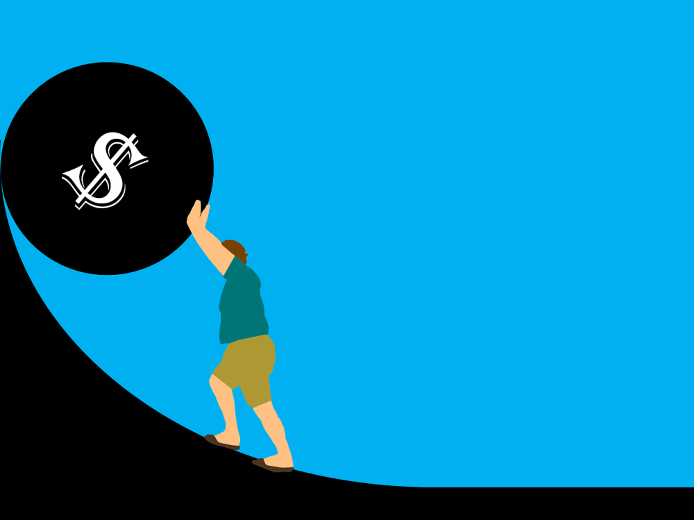 A graphic of a man in shorts and a t-shirt pushing up or holding against a vertical slope a large ball with a dollar sign on it