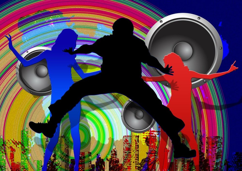 A graphical image of three silhouettes in blue, black, and red respectively of people dancing with a rainbow colored swirling disc, three large silver grey loudspeakers, and other assorted urban graphics behind them